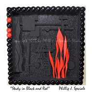 Three dimensional shadowbox expressing the colors black and red.